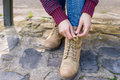 Woman is tying her boot Royalty Free Stock Photo