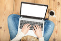 Woman typing on laptop wooden floor Royalty Free Stock Photos