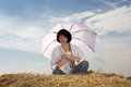 Woman with umbrella and a cup Royalty Free Stock Image