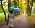 Woman with umbrella in the Park.