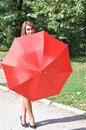 Woman with umbrella portrait of a beautiful holding a red concept of support protection insurance Stock Photos