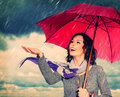 Woman with umbrella smiling over autumn rain background Stock Photo