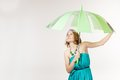 A woman with umbrella in a studio Royalty Free Stock Image