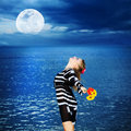 Woman under moon Stock Image