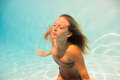 Woman undewater in the swimming pool Royalty Free Stock Photography