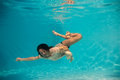 Woman undewater in the swimming pool Royalty Free Stock Photo