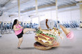 Woman with unhealthy foods in the fitness center Royalty Free Stock Photo