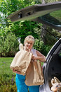Woman unloading the groceries Stock Photography