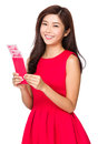 Woman with unwrapped chinese red pocket isolated on white background Stock Photos