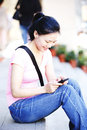 Woman use smartphone young asian outdoor Royalty Free Stock Photos