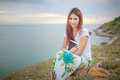 Woman use tablet young asian pc on mountain and sea Royalty Free Stock Images