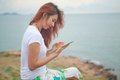 Woman use tablet young asian pc on mountain and sea Royalty Free Stock Photography