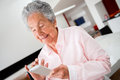 Woman using app on cell phone happy senior a Royalty Free Stock Photo