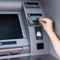 Woman using atm cash machine Royalty Free Stock Image