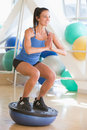 Woman Using On Balance Trainer At Gym Royalty Free Stock Photos