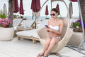 Woman Using Cell Phone by Pool of Luxury Resort Royalty Free Stock Photo