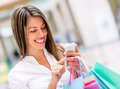 Woman using cell phone while shopping Royalty Free Stock Photo