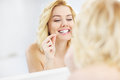 Woman using dental floss Royalty Free Stock Photo