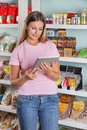 Woman using digital tablet in supermarket beautiful mid adult Stock Images