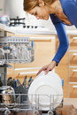 Woman using dishwasher Royalty Free Stock Photo