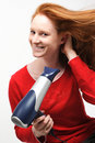 Woman Using Hairdryer Royalty Free Stock Photography