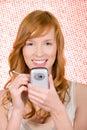 Woman using handheld computer Royalty Free Stock Photo