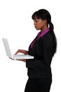 Woman using laptop attractive black isolated on white Royalty Free Stock Image