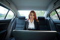 Woman using laptop beautiful young business asian in a car Royalty Free Stock Images