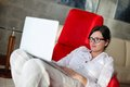 Woman using a laptop computer at home working on and relax modern Royalty Free Stock Images