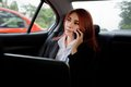 Woman using laptop and mobile phone beautiful young business asian in a car Royalty Free Stock Photo