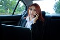 Woman using laptop and mobile phone beautiful young business asian in a car Stock Photos