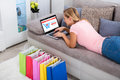 Woman Using Laptop For Online Shopping At Home Royalty Free Stock Photo