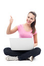 Woman using laptop and showing thumbs up young over white background Stock Photos