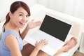 Woman using laptop on sofa Royalty Free Stock Photo