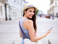 Woman using mobile phone on city street Royalty Free Stock Photo