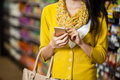 Woman using mobile phone in grocery section Royalty Free Stock Photo