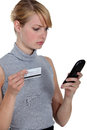 Woman using a phone card young Stock Photo