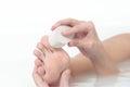 Woman using a pumice stone to exfoliate her feet Stock Photo