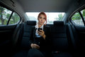 Woman using a smart phone beautiful young business asian in car Royalty Free Stock Photos