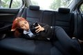 Woman using a smart phone beautiful young business asian in car Stock Photo