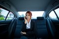 Woman using a smart phone beautiful young business asian in car Royalty Free Stock Images