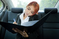 Woman using a smart phone beautiful young business asian and write in car Stock Photos