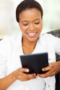 Woman using tablet beautiful young african american computer at home Stock Photography