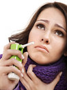 Woman using throat spray. Royalty Free Stock Image