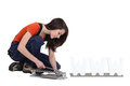 Woman using a tile cutter Stock Image