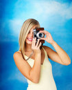 Woman using vintage camera Royalty Free Stock Images