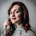 Woman using a vintage phone beautiful happy Stock Photography