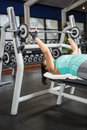 Woman using weight machines Royalty Free Stock Photo