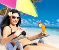 Woman on vacation at beach with thumbs up sign Stock Images