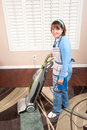 Woman vacuuming floor Royalty Free Stock Photography